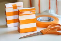 Make bags from envelopes and pretty tape -would be good as a party favor bag or for small stuff