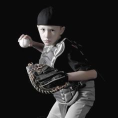 an interesting sports pose for baseball. need a baseball field background preferably