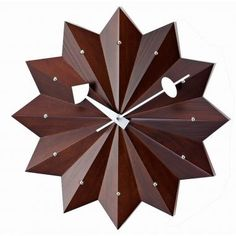 I love the concept of this piece, but I would be inclined to change out the hands to be more sleek and simplistic so as not to distract from the sculptural element of the rest of the design. To me, this looks like wooden origami. The wood tone is lovely, but you could paint it any color and achieve a more paper-like look. Anyway you take it, this clock is vintage-inspired modern at its coolest.