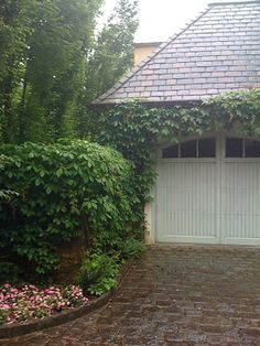 Small Pergola Over Garage Doors -- Check Out The Driveway!