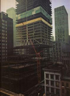 the citicorp building under construction looking southwest showing the old citibank building december 1975 #architecture #construction #newyork #nyc #ny #manhattan #skyscraper