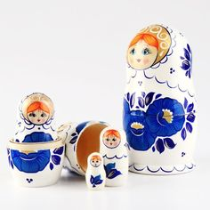 "Blue Golden Flower Doll - $35.99 This happy blue-eyed beauty matryoshka doll holds 4 smaller dolls with paintings of blue flowers, just as the main doll. The flowers, perhaps morning glories, are accented with gold centers and white decorative dots. This nearly 7"" tall doll is striking, fun, and ready to ship to you! Gloss finished."