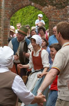 """https://flic.kr/p/gAVw7   Tudor Dance, Kentwell 1578   An impromptu Tudor dance lesson beside the bakery at <a href=""""http://www.kentwell.co.uk"""">Kentwell Hall</a>.  The  <a href=""""http://www.kentwell.co.uk/Re-Creations/index.html"""">Great Annual Tudor Re-Creation""""</a> features 300+ dedicated re-enactors in costume and in character around the Elizabethan house, farm and grounds. This year was 1578."""