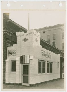 Exterior view of White Castle number 2. Located at 434 West Liberty St. (at 5th St.) in Louisville, Kentucky. Opened in October of 1927 and remodeled in 1931. White Castle sign reads 5 cent hamburgers.