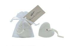 Scented ceramic heart. A heart-shaped scented pumice stone, beautifully packaged in a voile drawstring bag, with a satin hanging ribbon.