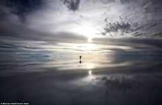 Taylor Kittell practices yoga on the Bolivian salt flats in this image captured by her husband Michael