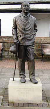 """CROWBOROUGH, ENGLAND l Arthur Conan Doyle statue in Crowborough reads """"Sir Arthur Conan Doyle, Resident of Crowborough, 1907–1930"""""""