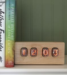 Vintage wood clock with Nixie tube time displays. This is different, and I like it. -D
