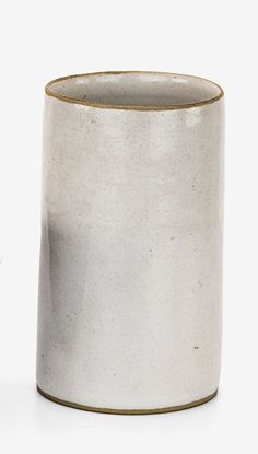 Lucie Rie Stoneware beaker, with white tin glaze, impressed LR seal mark to the base. H. 110mm