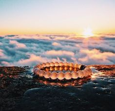 Lokai is injected with mud from the Dead Sea and injected in the white bead is water from Mt Everest. The highest and lowest points on earth signifying life's balance. Love mine <3