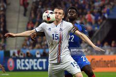 Jón Dadi Bödvarsson of Iceland holds off Samuel Umtiti of France during the UEFA EURO 2016 quarter final match between France and Iceland at Stade de France on July 3, 2016 in Paris, France.