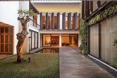 Built by Pranala Associates in Bandung, Indonesia with date 2013. Images by M. Ifran Nurdin . This modern house is actually two houses being designed as one building. Two families live there. It was built in 201...