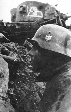 German soldier observe from his position - Eastern Front
