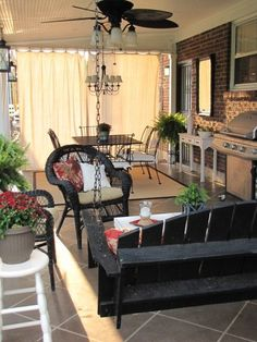 Love the painter's drop cloth curtains and this porch