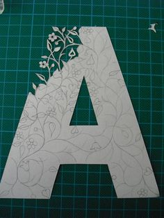"Papercut Initials    On this board why?  Get large paper letter, lay on shadow box, place paper on.  Make vine work on paper in shape of letter, but without specific lines.  Scan vined ""letter"" and save as bitmap.  Convert to machine embroidery pattern"