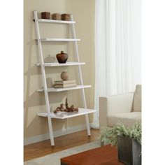 Made with durable steel and wood laminate and finished in a gorgeous white finish, this bookcase is great for your home of office. Showcase books and other collectibles with this stylish ladder bookcase.