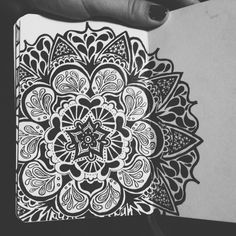 Another one of those mandala flowers Done with micron pens within a 3.5 x 5.5 sketchbook