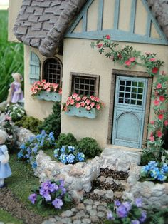 This is a photo of my Fairy Cottage.    It is a quarter scale kit by Suzanne and Andrews Minis.     The landscaping was very time consum...