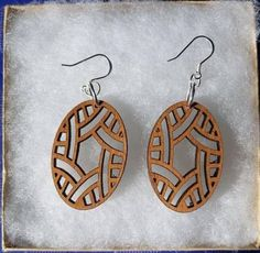 These Earrings are laser cut to create a matching pair. The Fish Hook wire and jump rings are Sterling Silver They measure approximately 1 x 1 x Have a custom design in mind? Please contact me. Custom Earrings, Wooden Earrings, Wooden Jewelry, Leather Earrings, Custom Jewelry, 3d Laser, Laser Cut Wood, Laser Cutting, Natural Accessories