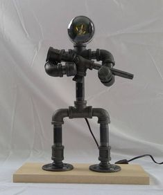 This black pipe US soldier lamp is truly unique and an amazing symbol of the proud men and women of steel who prepare themselves and serve willingly to protect our nation. Your favorite soldier, veteran, or patriot will love this lamp. The lamp sits on a hardwood base and has a six #LampIndustrial #pipelamp
