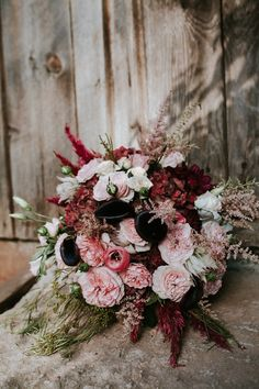 unique red pink and black bouquet