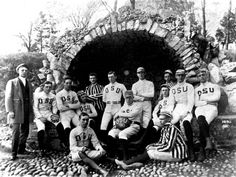 This 1890 photograph depicts the Ohio State University's first football team standing in front of the grotto at Mirror Lake on campus.