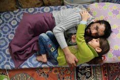 A Syrian Father Whose Face is Burned & Lost 2 Legs in a Barrel Bomb that Nearly Killed Him, His Daughter by His Side Hugging Him (Syrian Arab; 27 January 2016 CE Syria) -Abdullateef Khaled (FB)