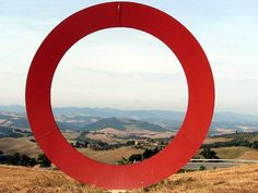 The Red Ring near Volterra, Italy. The is a sculpture like this in Munich by Mauro Staccioli. I don't know if this is a copy or another one by the same artist. There was nothing around it to identify it.