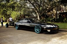 SC300 black with teal rims. Sweet!