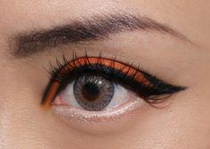 Cool Halloween graphic eye makeup to mimic :  Yaby Just Orange Eyeshadow and NARS Pandora Duo Eyeshadow
