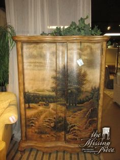"""Entertainment cabinet with crackle painted forest front doors. Inside there is space for a TV with one shelf at the top and two drawers below. There is also an optional wardrobe bar. 46""""wide x 22""""deep x 64""""high."""