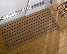 self draining shower mat. genius.  no more wet floors.