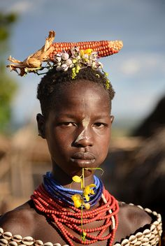 A Karo girl from the Omo Valley in Ethiopia, Africa. Travel to Ethiopia with Abeba Tours DMC. A member of Gondwana DMCs - your network of boutique Destination Management Companies across the globe - www.gondwana-dmcs.net
