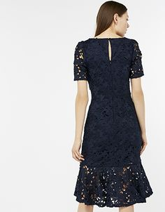 3f3626de8c64 A fluted hem gives flounce to our Rococco lace midi dress. With its large  florals