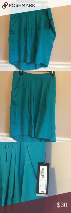Turquoise front pleated skirt with pockets NWT beautiful skirt. Pockets. Front shorter than back Worthington Skirts