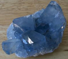 Celestite (SrSO4) is named for it's usual sky-blue color, but can appear in many other colors including clear, yellow, green, red, or brown. Crystals can be very large, sometimes weighing many pounds. It is too soft to be used as a gemstone, but is an important source of strontium compounds.