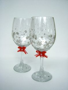 Winter theme wedding wine glasses with pearl snowflakes and red bows
