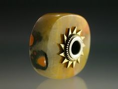 Bullfrog and I-Ching Beads Sterling silver, brass, bumblebee jasper