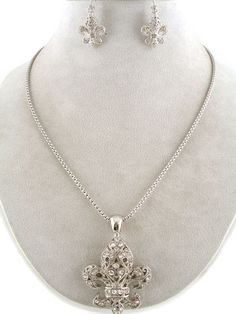 """CHUNKY 2"""" FLEUR DE LIS THEME SILVER TONE NECKLACE SET WITH CRYSTAL ACCENTS     * If you need a necklace extender I have them for sale in my store.*          NECKLACE: 16"""" L +  3"""" EXT    LOBSTER CLAW CLASP CLOSURE       HOOK EARRINGS           COLOR: SILVER TONE  $20.99"""