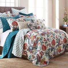 Embellish your bedroom with the serene ambiance of the Ellie Quilt Set from Levtex Home. Adorned in a classic botanical pattern in deep blue and red hues, this quilt will add a pop of color to your sleep space.