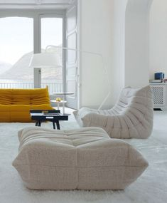 White Bright Color Togo Sofa  Coffee Table Completed Among White Rug Design under Modern Small Living Room Interior
