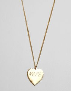 In God We Trust NOPE Necklace, $40 at Need Supply Co. This gold hand-etched pendant looks like a simple gold chain — but upon closer inspection, has just the right amount of 'tude. Throw it on along with other necklaces, or wear it just by itself under an open white dress shirt this summer.