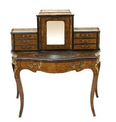 A 19th century gilt metal mounted marquetry inlaid figured walnut bonheur de jour, the fitted super-structure over a single drawer serpentine base, raised on cabriole supports, 120cm wide.