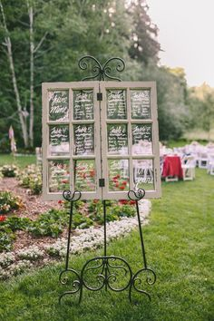Love the chic easel display for this window panel seating chart! {Photo by George Pahountis, courtesy of @nestldownllc}