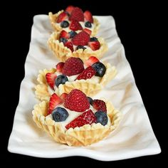 Italian Cookies-Pizzelle-thin, crispy waffle cookies flavoured with anise, shaped into cups, filled with Mascarpone Cream & fresh berries.