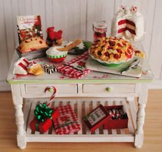 Miniature Christmas Baking Table With Christmas Cookies, Cherry Pie, Red Velvet and White Chocolate Cake