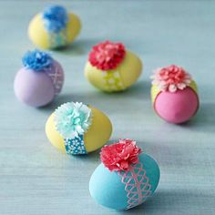 Jazz up Easter eggs with a decorative band and a cheerful paper flower.