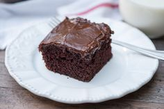 This One Bowl Chocolate Cake is nearly as easy to make as a boxed mix. This simple, classic recipe results in a perfect chocolate cake every time!