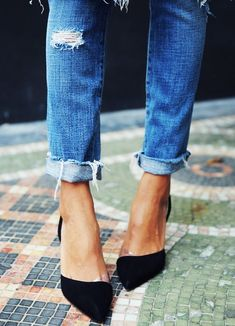 Black D'Orsay Heels and ripped jeans.
