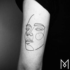 Single line portrait tattoo on the back of the left arm.